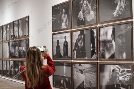 A visitor makes a picture by his phone at the exhibition 'Peter Lindbergh: untold stories', organized by the Kunstpalast in Düsseldorf in collaboration with the Peter Lindbergh Studio in Paris at the Artillery, in Turin, 12 May 2021. The exhibition runs from 13 May to 13 August 2021.