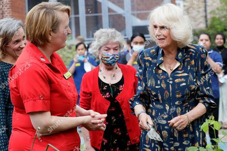 Stock Picture of Camilla, Camilla Duchess of Cornwall speaks to Michelle Johnson, Director of Nursing, left, as she visits the hospital gardens during a visit on International Nurse Day to Whittington Hospital in London