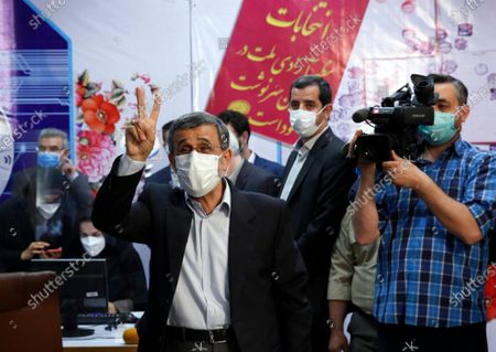 Stock Picture of Former Iranian President Mahmoud Ahmadinejad waves to media while registering as a candidate for the June 18 Presidential election at elections headquarters of the interior ministry in Tehran, Iran.