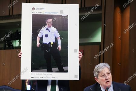 Stock Picture of Sen. John Kennedy, R-La., speaks as he shows a tweet from LeBron James during a Senate Appropriations committee hearing to examine domestic extremism, on Capitol Hill in Washington