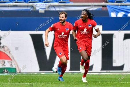 Berlin's Dedryck Boyata, right, celebrates after scoring during the German Bundesliga soccer match between Hertha BSC Berlin and FC Schalke 04 in Gelsenkirchen, Germany