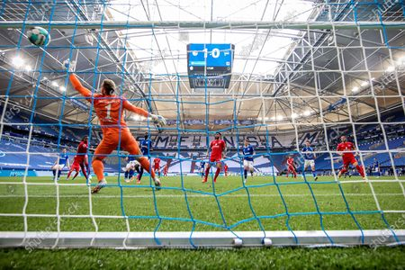 Hertha's Dedryck Boyata (rear-L) scores the 1-1 equalizer during the German Bundesliga soccer match between FC Schalke 04 and Hertha BSC Berlin in Gelsenkirchen, Germany, 12 May 2021.