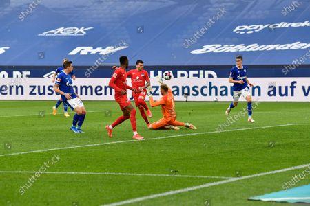 Berlin's Nemanja Radonjic (24) misses a scoring chance against Schalke's goalkeeper Ralf Faehrmann (1) during the German Bundesliga soccer match between Hertha BSC Berlin and FC Schalke 04 in Gelsenkirchen, Germany