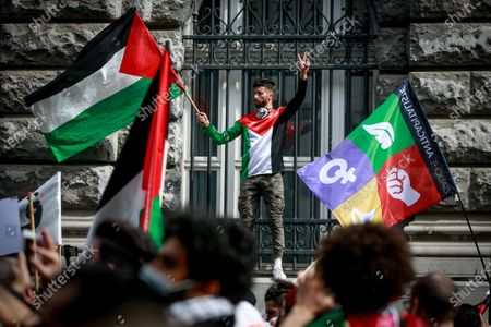 People demonstrate at a rally organized by several associations, including the Belgian-Palestinian Association (ABP), in support of the Palestinian people, in Brussels, Belgium, 12 May 2021. Protesters called for a free Palestine. In response to days of violent confrontations between Israeli security forces and Palestinians in Jerusalem, various Palestinian militants factions in Gaza launched rocket attacks on 10 and 11 May that killed three Israelis. Israel Defense Forces (IDF) said they hit over 100 targets in Gaza Strip during retaliatory overnight strikes on 10 May and Israeli Prime Minister Benjamin Netanyahu said on 11 May that they will increase the rate and intensity of the strikes. The Gaza Strip's health ministry said that at least 40 Palestinians, including 13 children, were killed in the recent Israeli airstrikes to date.