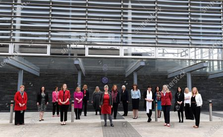 Welsh Labour female elected members of the Senedd (L-R) Joyce Watson MS, Vikki Howells MS, Dawn Bowden MS, Sarah Murphy MS, Lynne Neagle MS, Carolyn Thomas MS, Julie James MS, Jane Hutt MS, Julie Morgan MS, Jenny Rathbone MS, Lesley Griffiths MS, Rhianon Passmore MS, Eluned Morgan MS, Hannah Blythyn MS, Buffy Williams MS, Rebecca Evans MS and Jayne Bryant MS stand in front of a plaque in remembrance of Valerie Feld during the first day of Welsh Parliament at the Senedd in Cardiff Bay.