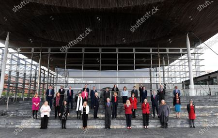 (L-R) Welsh Labour members of the Senedd Lynne Neagle MS, Rebecca Evans MS, Alun Davies MS, Julie Morgan MS, Hefin David MS, Buffy Williams MS, John Griffiths MS, Rhianon Passmore MS, Dawn Bowden MS, Jeremy Miles MS, Jayne Bryant MS, Mick Antoniw MS, Jenny Rathbone MS, Mike Hedges MS, Mark Drakeford MS, Carolyn Thomas MS, Vikki Howells MS, Lesley Griffiths MS, Hannah Blythyn MS, Joyce Watson MS, Lee Waters MS, Jack Sargeant MS, Sarah Murphy MS, Ken Skates MS, Huw Irranca-Davies MS, Julie James MS, David Rees MS, Eluned Morgan MS, Vaughan Gething MS and Jane Hutt MS during the first day of Welsh Parliament at the Senedd in Cardiff Bay.