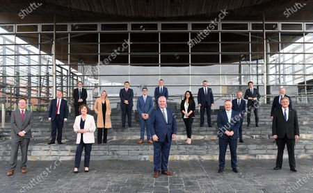 Stock Photo of (L-R) Welsh Conservatives Members of the Senedd George Russell MS, Paul Davies MS, Joel James MS, Janet Finch-Saunders MS, Laura Anne Jones MS, Tom Giffard MS, James Evans MS, Gareth Davies MS, Andrew RT Davies MS, Natasha Asghar MS, Samuel Kurtz MS, Darren Millar MS, Altaf Hussain MS, Sam Rowlands MS, Peter Fox MS and Mark Isherwood MS during the first day of Welsh Parliament at the Senedd in Cardiff Bay.