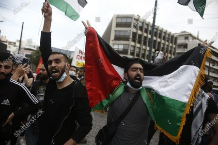 Palestinians living in Greece shout slogans during a rally amid heightened tensions between Israel and the Palestinian Territories, outside the Israeli Embassy in Athens, Greece, 12 May 2021. In response to days of violent confrontations between Israeli security forces and Palestinians in Jerusalem, various Palestinian militants factions in Gaza launched rocket attacks on 10 and 11 May that killed three Israelis. Israel Defense Forces (IDF) said they hit over 100 targets in Gaza Strip during retaliatory overnight strikes on 10 May and Israeli Prime Minister Benjamin Netanyahu said on 11 May that they will increase the rate and intensity of the strikes.