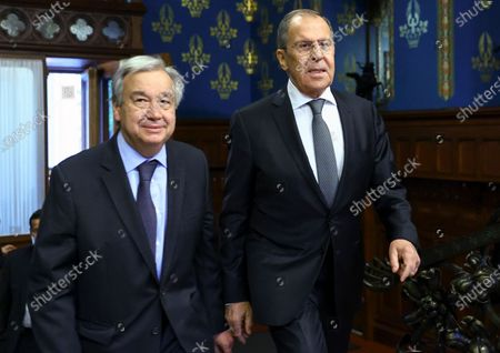 In this photo released by the Russian Foreign Ministry Press Service, Russian Foreign Minister Sergey Lavrov, right, and UN Secretary-General Antonio Guterres arrive for the talks in Moscow, Russia