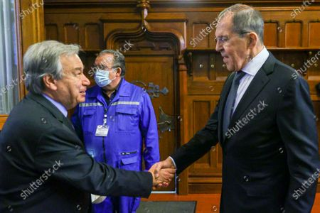 In this photo released by the Russian Foreign Ministry Press Service, Russian Foreign Minister Sergey Lavrov, right, greets UN Secretary-General Antonio Guterres prior to talks in Moscow, Russia