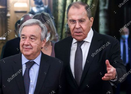 Russian Foreign Minister Sergey Lavrov, right, welcomes UN Secretary-General Antonio Guterres for the talks in Moscow, Russia