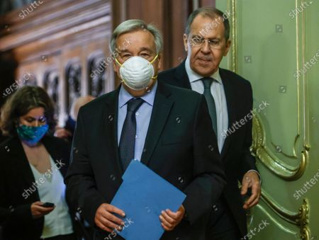 Secretary-General Antonio Guterres, foreground and Russian Foreign Minister Sergey Lavrov enter a hall for their joint news conference following their talks, in Moscow, Russia