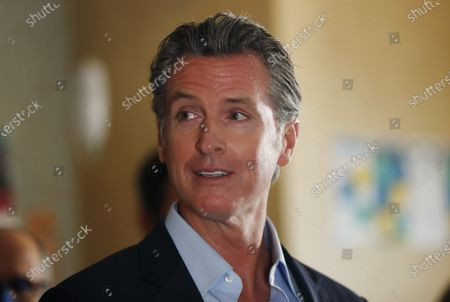 Governor Gavin Newsom speaks at a news conference about a $12 billion package bolstering the state's response to the homelessness crisis at the Kearney Vista Apartments, which houses homeless people in a converted hotel on Tuesday, May 11, 2021 in San Diego, CA.