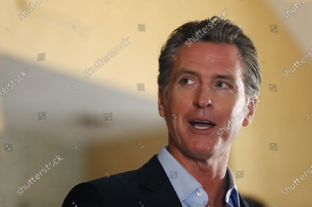 Stock Image of Governor Gavin Newsom speaks at a news conference about a $12 billion package bolstering the state's response to the homelessness crisis at the Kearney Vista Apartments, which houses homeless people in a converted hotel on Tuesday, May 11, 2021 in San Diego, CA.