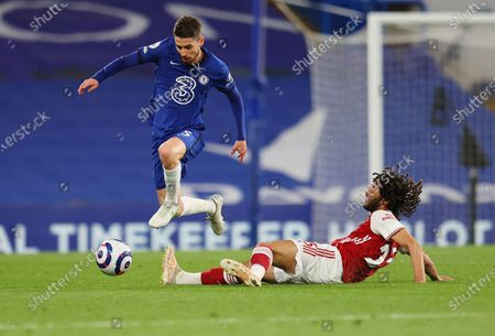 Chelsea's Jorginho, top, is tackled by Arsenal's Mohamed Elneny during the English Premier League soccer match between Chelsea and Arsenal at Stamford Bridge stadium in London, England