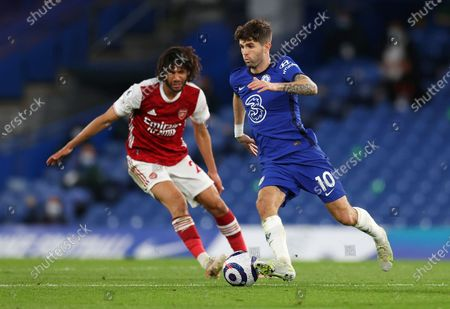 Chelsea's Christian Pulisic, right, challenges for the ball with Arsenal's Mohamed Elneny during the English Premier League soccer match between Chelsea and Arsenal at Stamford Bridge stadium in London, England