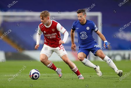Arsenal's Emile Smith Rowe, left, challenges for the ball with Chelsea's Hakim Ziyech during the English Premier League soccer match between Chelsea and Arsenal at Stamford Bridge stadium in London, England