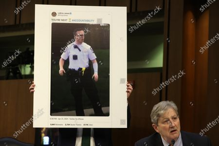 """WASHINGTON, DC - MAY 12: United States Senator John Neely Kennedy (Republican of Louisiana) speaks as he shows a tweet from LeBron James during a hearing before the Senate Appropriations Committee at Hart Senate Office Building on Capitol Hill in Washington, DC. The committee held a hearing on """"Domestic Violent Extremism in America."""""""