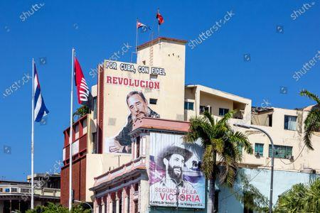 Stock Picture of Images of Fidel Castro and Camilo Cienfuegos in the CODESA building in Santiago de Cuba, Cuba