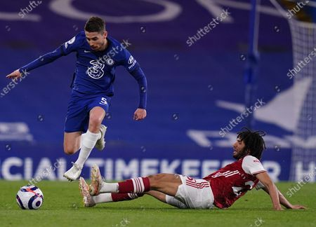 Chelsea's Jorginho (L) in action against Arsenal's Mohamed Elneny (R) during the English Premier League soccer match between Chelsea FC and Arsenal FC in London, Britain, 12 May 2021.
