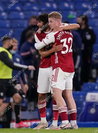 Arsenal's Mohamed Elneny (L) and Emile Smith Rowe (R) celebrate after the English Premier League soccer match between Chelsea FC and Arsenal FC in London, Britain, 12 May 2021.