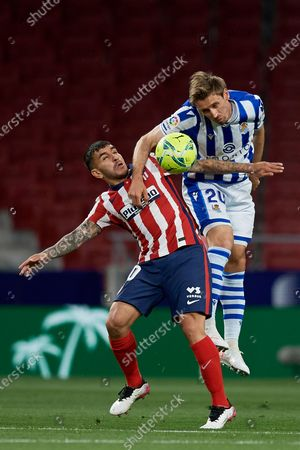 Nacho Monreal of Real Sociedad and Angel Correa of Atletico Madrid compete for the ball during the La Liga Santander match between Atletico de Madrid and Real Sociedad at Estadio Wanda Metropolitano on May 12, 2021 in Madrid, Spain. Sporting stadiums around Spain remain under strict restrictions due to the Coronavirus Pandemic as Government social distancing laws prohibit fans inside venues resulting in games being played behind closed doors.