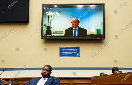 Rep. Byron Donalds, R-Fla., listens as as former acting Attorney General Jeffrey Rosen testifiess remotely Rep. James Comer, R-Ky., talks with Chairwoman Carolyn Maloney, D-N.Y., before a House Oversight and Reform Committee regarding the on Jan. 6 attack on the U.S. Capitol, on Capitol Hill in Washington