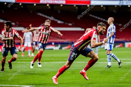 Atletico Madrid's Yannick Carrasco celebrates after scoring his side's first goal during the Spanish La Liga soccer match between Atletico Madrid and Real Sociedad at the Wanda Metropolitano stadium in Madrid, Spain