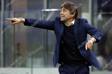 Stock Image of Inter Milan's coach Antonio Conte gestures during the Italian serie A soccer match between FC Inter and As Roma at Giuseppe Meazza stadium in Milan, Italy, 12 May 2021.