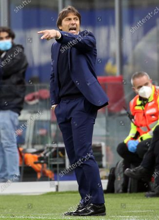 Stock Photo of Inter Milan's coach Antonio Conte reacts to Lautaro Martinez during the Italian serie A soccer match between FC Inter and As Roma at Giuseppe Meazza stadium in Milan, Italy, 12 May 2021.