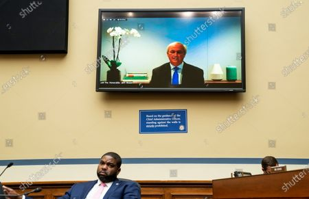 """Stock Photo of UNITED STATES - MAY 12: United States Representative Byron Donalds (Republican of Florida), listens as former acting Attorney General Jeffrey Rosen testifies during the House Oversight and Reform Committee hearing on """"The Capitol Insurrection: Unexplained Delays and Unanswered Questions""""."""