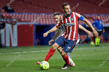 Stock Picture of Koke Resurreccion of Atletico de Madrid and Joseba Zaldua of Real Sociedad