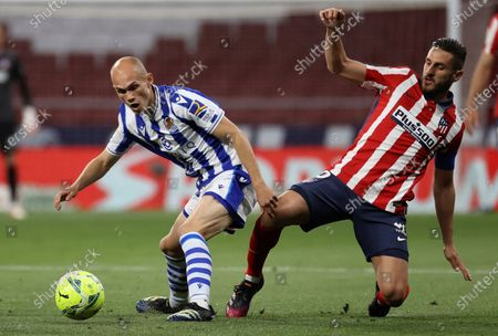 Stock Image of Atletico's defender Koke Resurreccion (R) fights for the ball against Real Sociedad's midfielder Jon Guridi (L) during the Spanish LaLiga soccer match between Atletico de Madrid and Real Sociedad at Wanda Metropolitano stadium in Madrid, Spain, 12 May 2021.