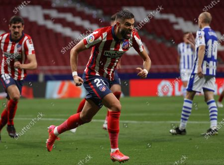 Stock Photo of Atletico's winger Yannick Ferreira-Carrasco celebrates after scoring the 1-0 lead during the Spanish LaLiga soccer match between Atletico de Madrid and Real Sociedad at Wanda Metropolitano stadium in Madrid, Spain, 12 May 2021.