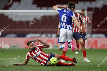 Stock Photo of Atletico's midfielder Saul Niguez (L) fights for the ball against Real Sociedad's defender Aritz Elustondo (R) during the Spanish LaLiga soccer match between Atletico de Madrid and Real Sociedad at Wanda Metropolitano stadium in Madrid, Spain, 12 May 2021.