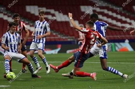 Atletico's winger Yannick Ferreira-Carrasco scores the 1-0 lead during the Spanish LaLiga soccer match between Atletico de Madrid and Real Sociedad at Wanda Metropolitano stadium in Madrid, Spain, 12 May 2021.