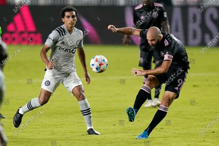 Inter Miami forward Gonzalo Higuain (9) kicks the ball as Montreal midfielder Ahmed Hamdi watches during the first half of an MLS soccer match, in Fort Lauderdale, Fla
