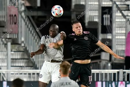 Stock Image of Montreal defender Kamal Miller, left, and Inter Miami defender Ryan Shawcross go for a head ball during the second half of an MLS soccer match, in Fort Lauderdale, Fla. Montreal won 2-0