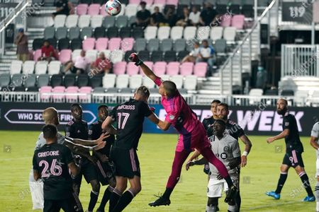 Inter Miami goalkeeper John McCarthy, center, defends the goal against a shot by Montreal during the second half of an MLS soccer match, in Fort Lauderdale, Fla. Montreal won 2-0