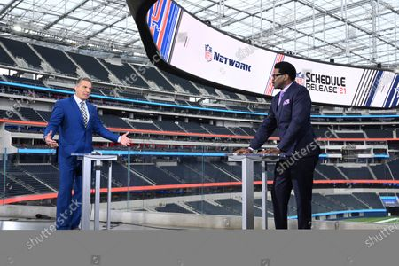 Network's Kurt Warner, left, and NFL Network's Michael Irvin host the NFL 2021-22 schedule release show, in Los Angeles
