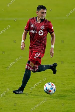 Stock Photo of Toronto FC midfielder Marco Delgado (8) moves the ball against the Columbus Crew during the second half of an MLS soccer match, in Orlando, Fla