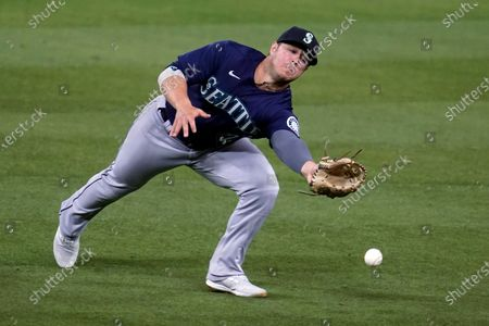 Stock Image of Seattle Mariners second baseman Ty France reaches for but can't catch a fly ball from Los Angeles Dodgers' Will Smith during the fourth inning of a baseball game, in Los Angeles. Smith singled on the play