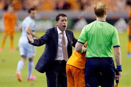 Stock Photo of Houston Dynamo head coach Tab Ramos, middle, argues a no-call to the assistant referee outside of the box during the second half of an MLS soccer match, in Houston. Ramos received a red card for the infraction
