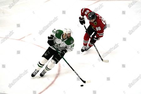Dallas Stars center Jason Dickinson (18) looks to pass against Chicago Blackhawks right wing Patrick Kane (88) during the third period of an NHL hockey game in Chicago