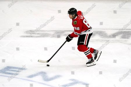 Chicago Blackhawks right wing Patrick Kane (88) controls the puck during the first period of an NHL hockey game against the Dallas Stars in Chicago