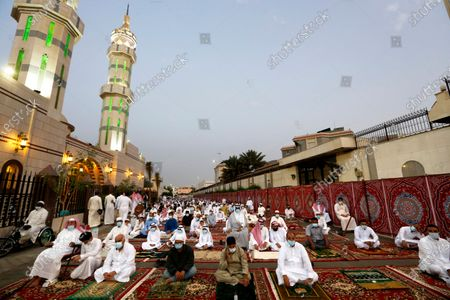Muslims wearing masks and keeping social distancing to curb the spread of coronavirus outbreak, perform an Eid al-Fitr prayer marking the end of the holy fasting month of Ramadan at al-Mirabi Mosque in Jiddah, Saudi Arabia