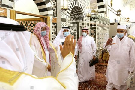 Men congratulate each other wearing masks and keep social distancing to help curb the spread of coronavirus outbreak after they perform Eid al Fitr prayers marking the end of the holy fasting month of Ramadan at al-Mirabi Mosque in Jiddah, Saudi Arabia