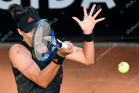 Stock Photo of Garbine Muguruza of Spain in action against Elina Svitolina of Ukraine during their women's singles third round match at the Italian Open tennis tournament in Rome, Italy, 13 May 2021.