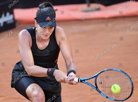 Stock Picture of Garbine Muguruza of Spain in action against Elina Svitolina of Ukraine during their women's singles third round match at the Italian Open tennis tournament in Rome, Italy, 13 May 2021.