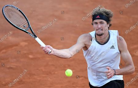 Alexander Zverev of Germany in action against Kei Nishikori of Japan during their men's singles third round match at the Italian Open tennis tournament in Rome, Italy, 13 May 2021.